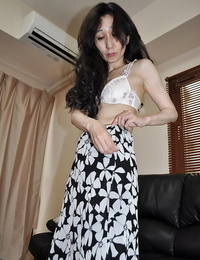 Asian mature lassie Nobue Toyoshima stripping and taunting her wooly twat