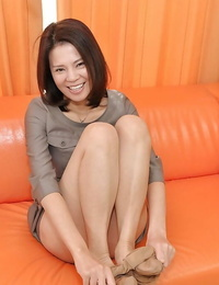 Asian Mummy in rosebutt getting rid of her bottom and toying her vagina