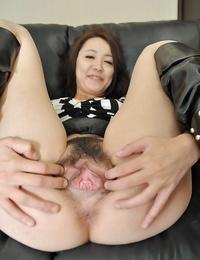 Asian Mummy Aya Nakano takes off her subjugation and has some vagina playing fun