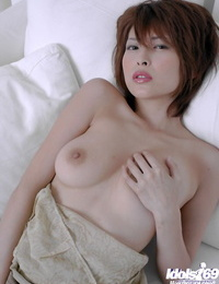 Barely clothed asian stunner Nana Natsume taunting her wooly pussy
