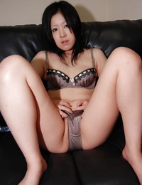 Asian girl Riko Anzai stripping and exposing her inviting holes in close up