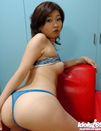 Diminutive asian hotty with puffy knockers taking off her top and undies