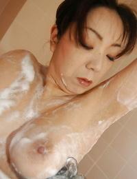 Mature asian lassie Yoriko Akiyoshi taking shower and massaging herself