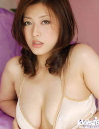 Alluring asian honey with engulfs gams revealing her diminutive tits