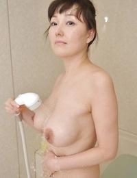 Frisky asian Mummy with shapely tits Kuniko Hara taking bathtub