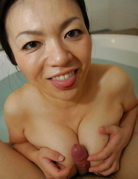 Saucy asian Mummy gives a sensual boob and blowjob in the bath
