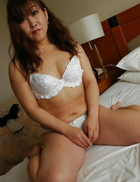 Asian mature lady Keiko Chiba getting naked and playing with her hookup fucktoys