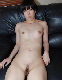 Asian cutie Rina Iida gets naked and has some pussy fingering fun