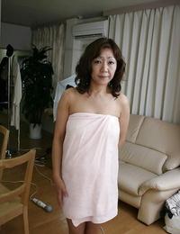 Sex-hungry asian Mummy Eriko Nishimura demonstrating her unshaven twat