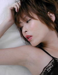 Seductive asian babe Nana Natsume unclothing off her undergarments on the bed