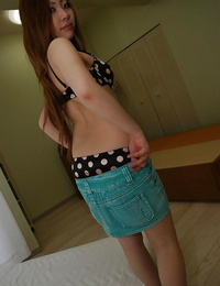 Asian teenager Yuna Uchiyama disrobing and uncovering her bushy pussy in close up