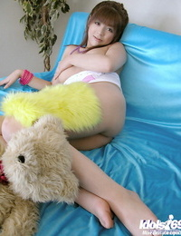 Lovely asian slobber-filled uncovering her pointy jugs and taking off her panties