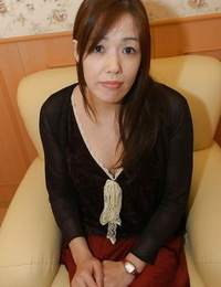 Asian Mummy with furry cootchie Eiko Sakai undressing and stretching her legs