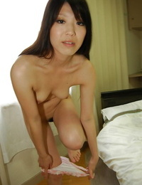Asian drool-filled in pantyhose undressing and opening up her vagina lips in close up