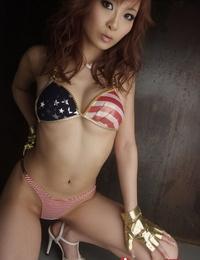 Redhead Asian Misa Kikouden showcases her inviting figure and rails a dildo