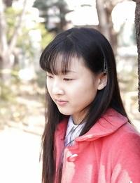 Lusty asian schoolgirl Youko Sasaoka sliding off her uniform