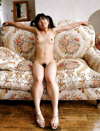 Thin asian babe with mind-blowing pouch posing nude and stretching her legs