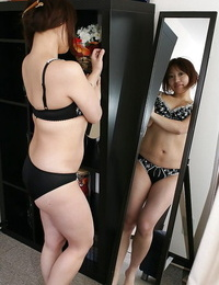 Asian MILF Rika Okabe unclothing and displaying her photos in close up