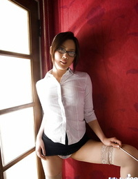 Foxy asian babe Haruka Yagami slipping off her suit and sheer undergarments