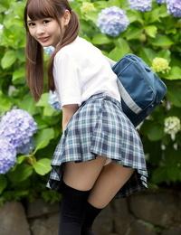 Cutie Japanese schoolgirl in pigtails shows bare ass in no undies upskirt