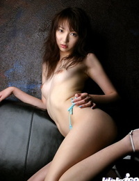 Slutty asian babe revealing her petite arched and unshaven vagina