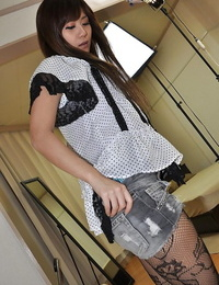 Foxy asian teen Nozomi Kahara undressing and playing with a vibrator