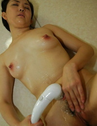 Fuckable asian MILF taking shower and taunting her wooly coochie in close up