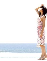 Cute asian honey Saki Ninomiya slipping off her dress and panties outdoor