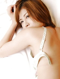 Seductive asian girl in rosebutt leisurely getting rid of her clothes