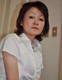 Shy mature asian girl Takako Kumagaya undressing and spreading her legs