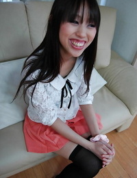 Smiley asian lady getting naked and exposing S/M g-spot in close up