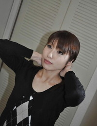 Asian expert Kaoru Fujitani uncovering her puffy hooters and hairless coochie