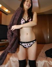 Asian teen Airi Kawaguchi disrobing down and teasing her soddening cunt