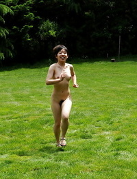 Nude asian hotty with lil\' boobs and hairy vagina having joy outdoor