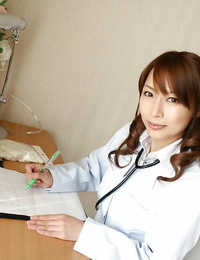 Horny asian doctor in glasses unveiling her nice tits with hard puffies
