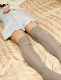 asian teenage in nylon knee socks stripping and exposing her vagina in close up