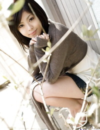 Tongues asian stunner with magnificent gams China Yuki slipping off her clothes