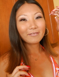 Asian amateur Miki posing fully clothed in blue jeans and bikini top