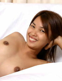 Amateur Asian honey in jeans revealing big innate hooters while undressing