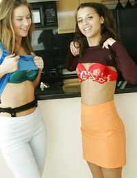 Tempting unexperienced lesbians with tiny hooters undressing and smooching each other