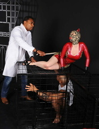 Wonderful fetish honey Latex Lucy gets manhandled and caged by two captured men