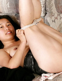 Oriental chick Mini posing completely clothed in jeans skirt before disrobing