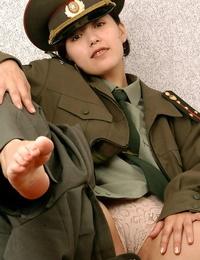 Korean inexperienced Elena undressing off military uniform to pose naked