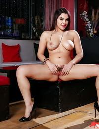 Curvaceous Mummy Valentina Nappi showcasing off long gams before baring big tits
