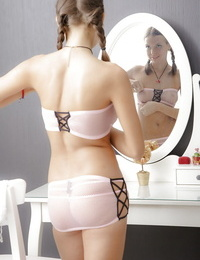 Slim teen with ponytails Carre displays off in a tasty undergarments