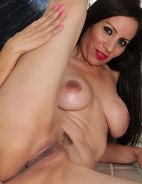 Brunette milf stunner Carmen Jones is showcasing her pussy while spreading gams