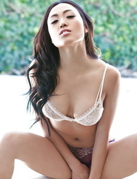 Alluring asian babe Kitty Lee demonstrating off her tempting forms