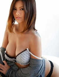 Asian sweetheart revealing her tits with hard puffies and hairless vagina