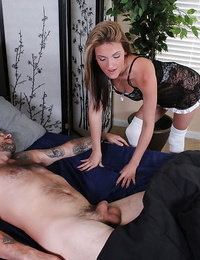 Naughty maid in stockings giving a handjob to a stud while hes sleeping