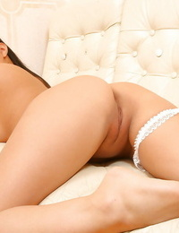 Naughty Asian amateur Courtney posing seductively in maids uniform